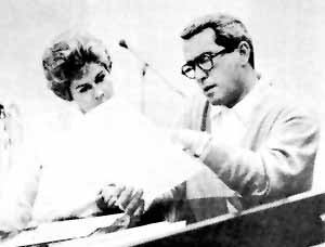 ~ Arranger Anita Kerr and Perry go over some music.